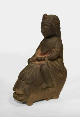 Figure Seated on Foo Dog